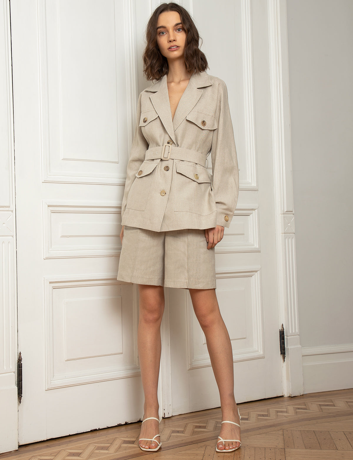 Khaki-colored belted safari jacket with matching shorts