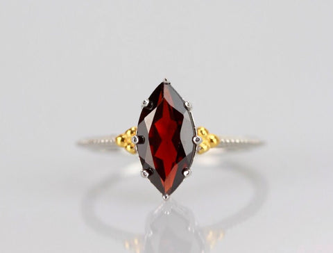 The legendary navette ring in garnet