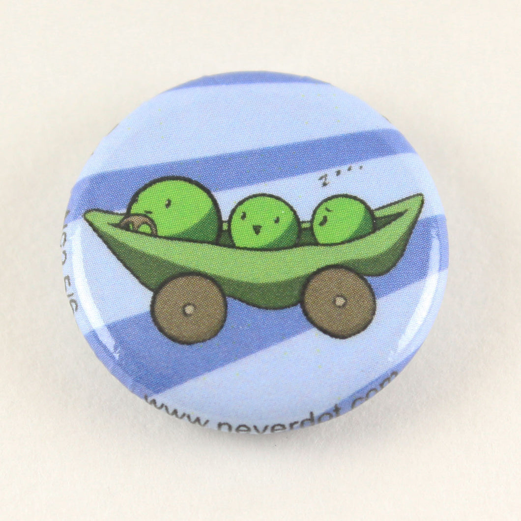 Magnet button with three peas in a pea pod equipped with wheels, steering, and limited brakes.  One of the peas is asleep, which doesn't bode well for their trip to Disney World later on