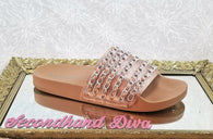 Report rose gold slides