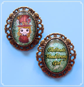 Steampunk Sally mini brooch set on green brocade, part of my Steampunk collection and suitable for girls of all sizes! The setting has a loop soldered to the back so wear as a necklace or brooch!