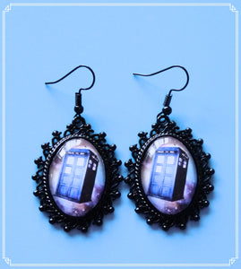 Police Box Galaxy statement drop earrings.
