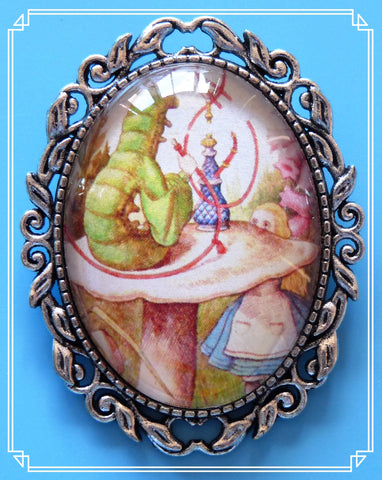 Alice and the Caterpillar brooch is an illustration by John Tenniel for the original Alice in Wonderland books.