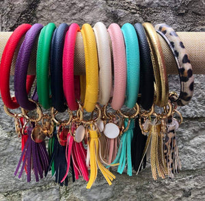 Vegan leather bracelet bangle keyring.  Removeable tassel and monogramable tag.