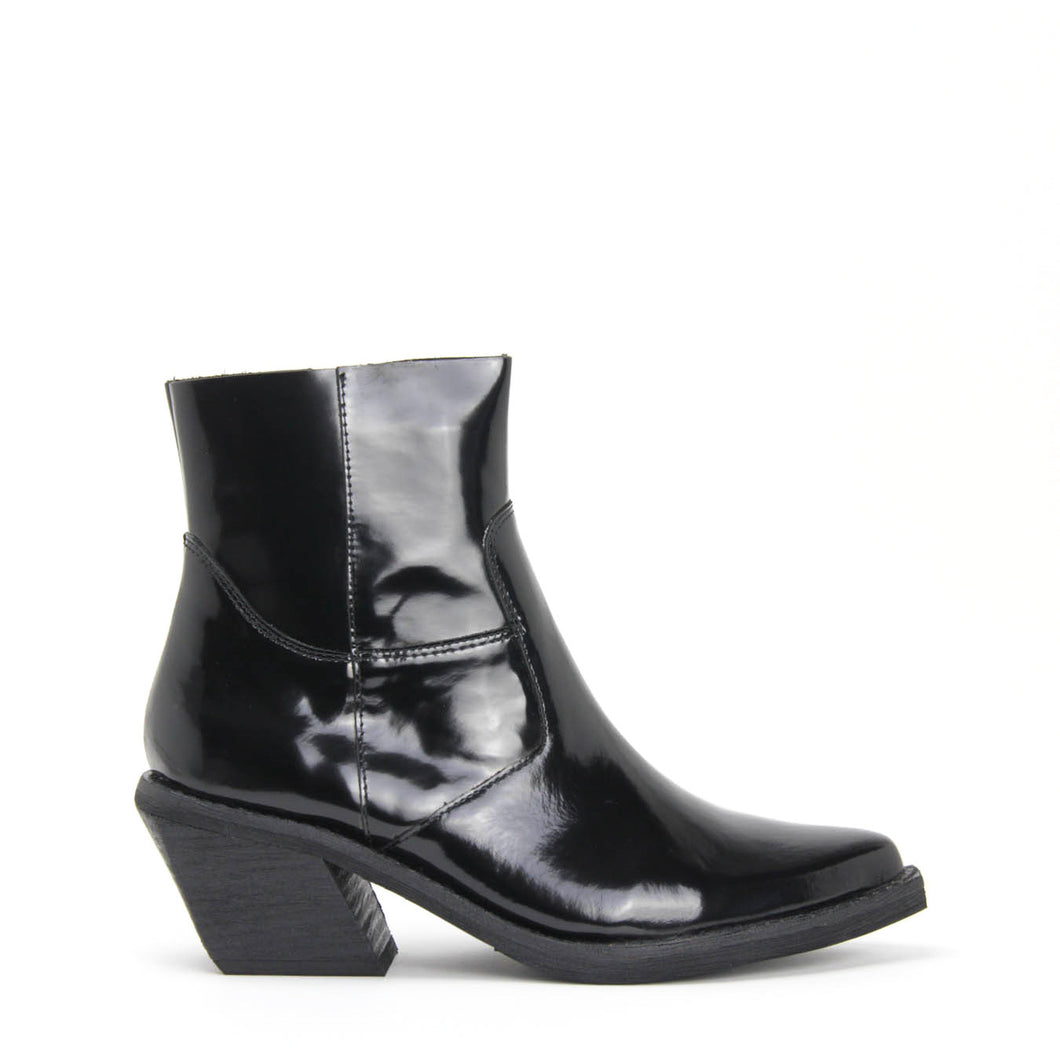 JEFFREY CAMPBELL CRUSADO Western Inspired Raw Cut Ankle Boot black shine leather. Pointed chiseled toe. Stacked 5.5cm Cuban heel. Shop Now Pay Later, Afterpay.