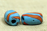Venetian light blue glass bead with stripe