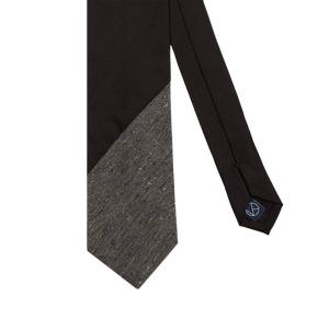 Two-piece necktie with a black silk main part combined with a textured gray on the tip.