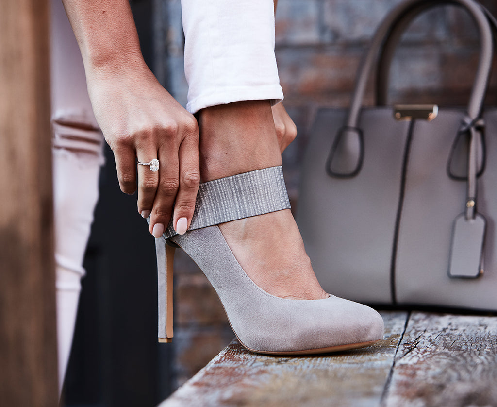 confident woman in pumps and reversible grey high heel strap in city