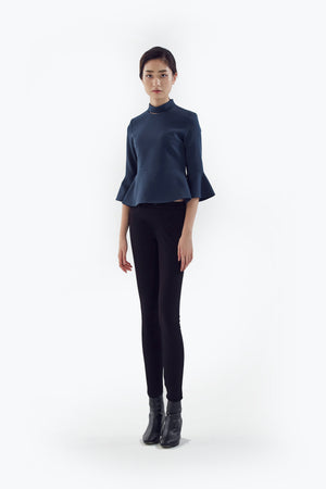blue top with flared sleeves
