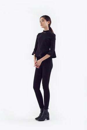 black top with flared sleeves