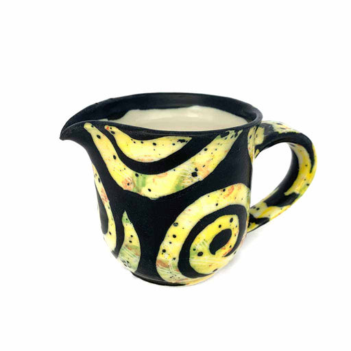 Buy 'yellow arabesque milk jug' handmade ceramics by George Ormerod at The Biscuit Factory