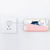Universal wall charger phone holder
