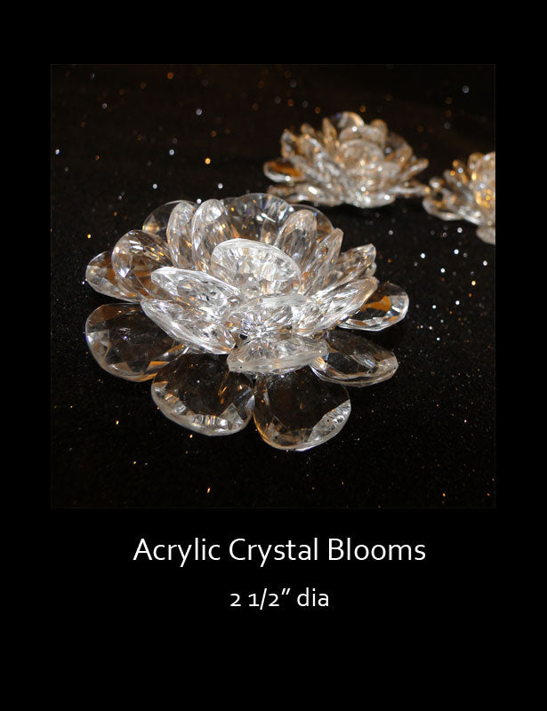 This crystal clear acrylic flower has many round petals and a rhinestone center. It's flat bottom makes it easy to glue to most surfaces.