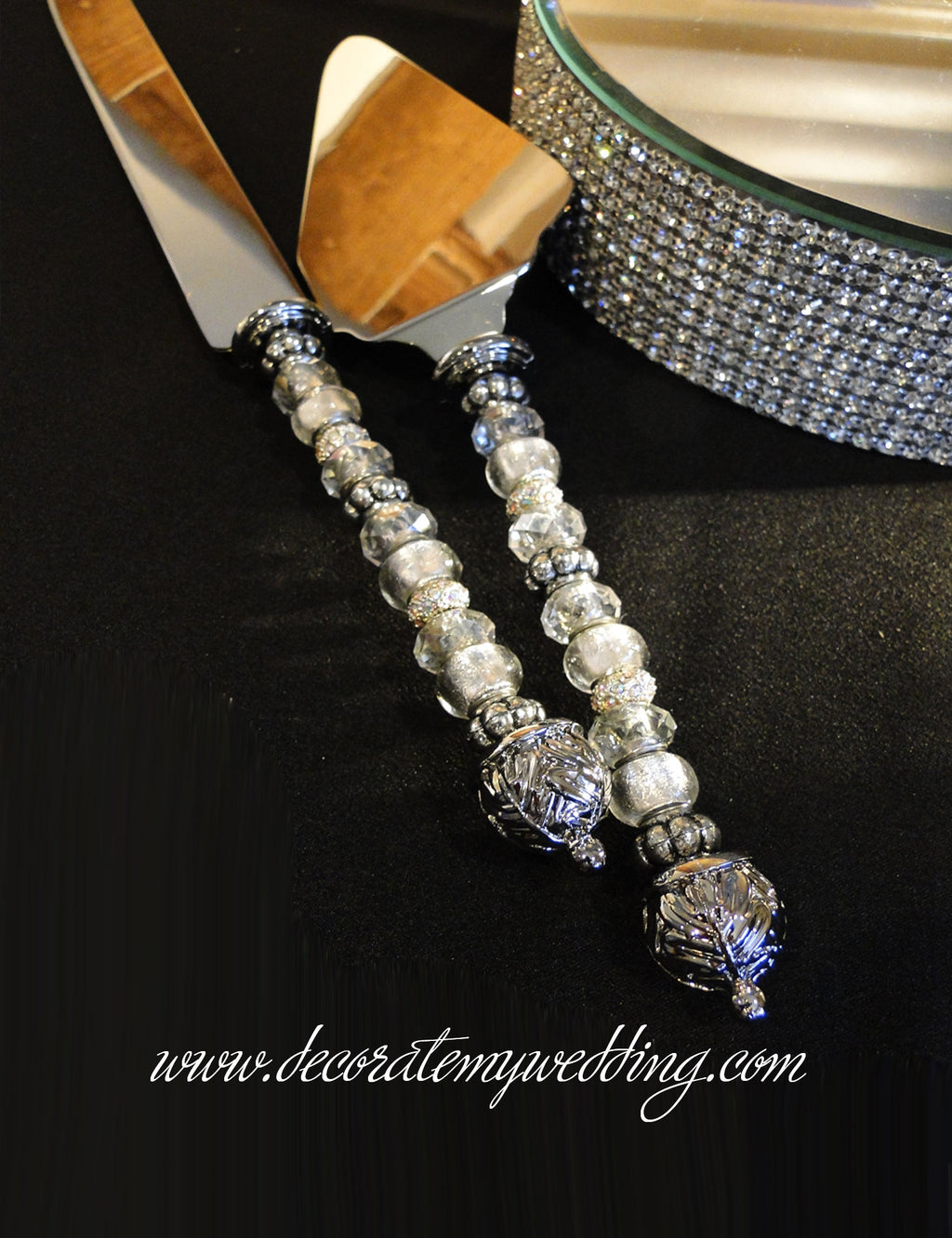 The handle on this beaded cake knife is covered with gorgeous silver and clear beads.