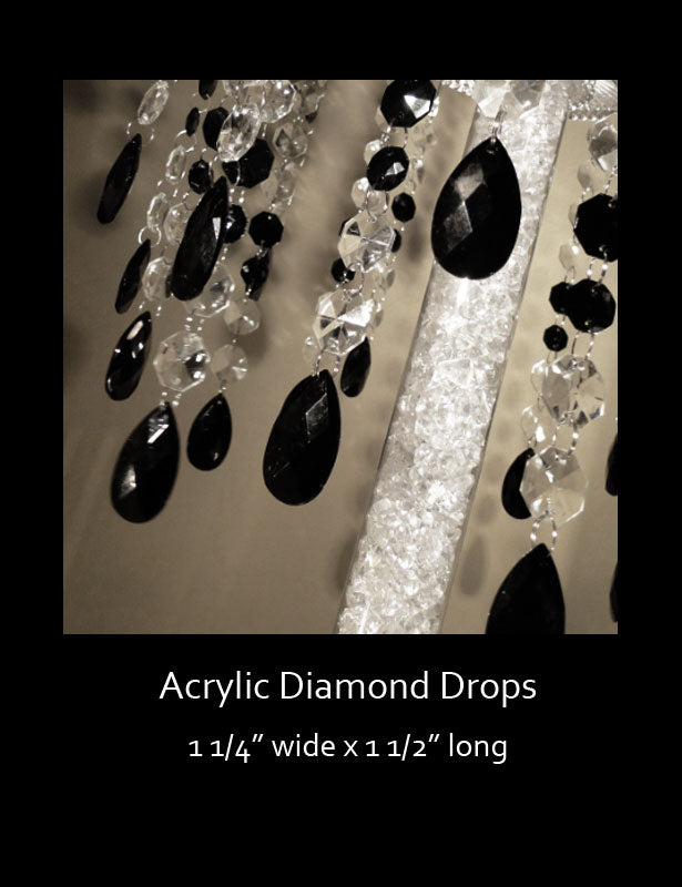 Black teardrops dangling from clear and black octagon bead strands.