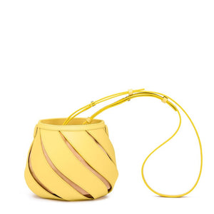 yellow bucket bag sling bag with cut outs edgability front view