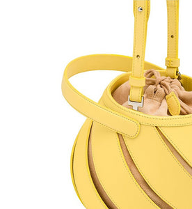 yellow bucket bag sling bag with cut outs edgability detail view