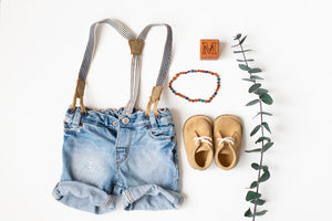 Flat Lay with Baltic Amber Teething Necklace in 'Maverick'