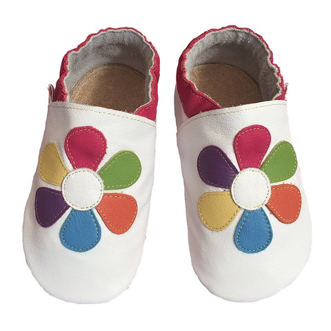 White baby shoes with colourful daisy