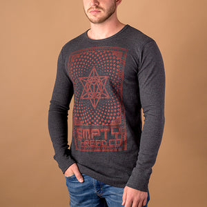 young male wearing charcoal black long sleeve thermal tee with merkaba printed in red on front