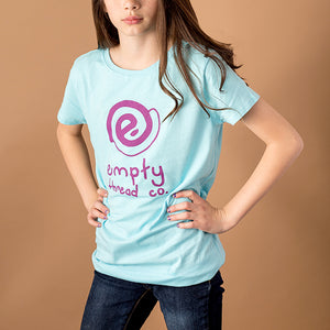 youth girl wearing baby blue girls cut tee with empty logo and the words empty thread co printed in purple