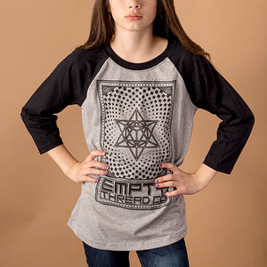youth female wearing 3/4 sleeve baseball tee with black sleeves and grey body with merkaba design printed in black on front