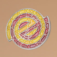enamel pin of shattered empty logo in yellow and red