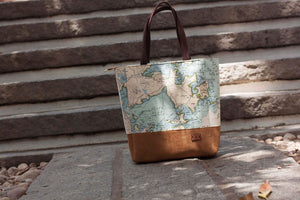 Map print with tan suede accented Jet Setter Tote