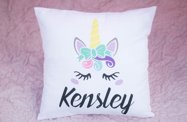 Kensley unicorn pillow close up showing unicorn eyelashes, colors and horn