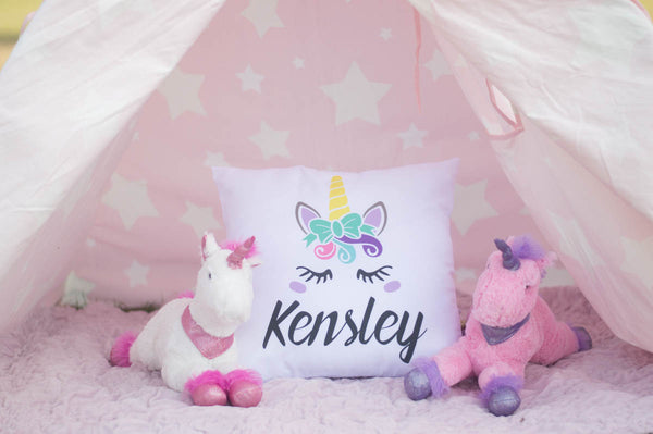 Kensley unicorn pillow in little girl's bedroom with unicorn stuffed animals