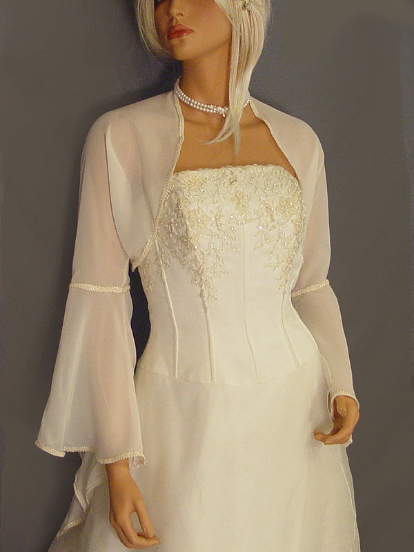 Audrey in Chiffon with trim and long large pointed bell sleeves