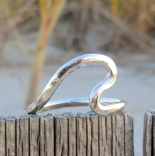 Endless Summer Style Wave Ring in Sterling Silver picture taken on the beach