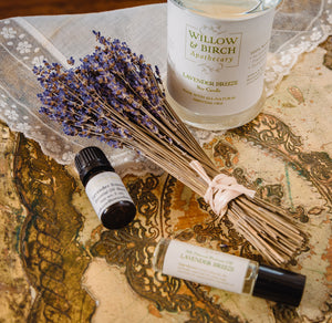 Lavender Breeze scented natural bath, beauty, and fragrance products by Willow & Birch Apothecary pictured with lavender bouquet and antique lace