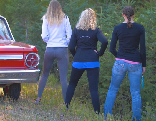 ladies stand to pee urinate standing on road trip