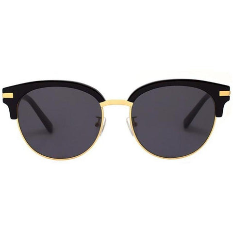 Black and round brow line sunglasses with gold rims and temples view 1