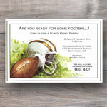 football invitations with helmet sitting on an open field