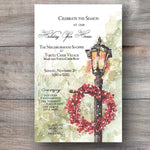 Christmas invitations with lamp post, snow flurries and a red wreath