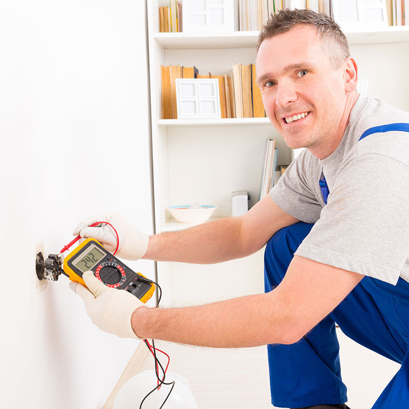 electrician installing smart lighting