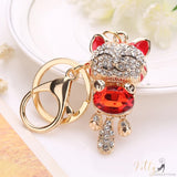 golden cat keychain with a red gemstone kittysensations