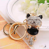 golden cat keychain with a black gemstone kittysensations