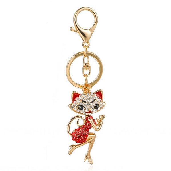 golden cat keychain with red rose quartz white background