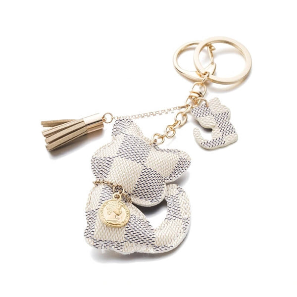 white leather cat keychain on white background