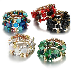 Picture of 5 choices of styles of bangles, beads and stone bracelets.