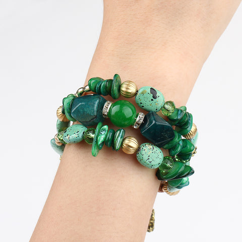 Picture of green version of bangles, beads and stone bracelet being worn.