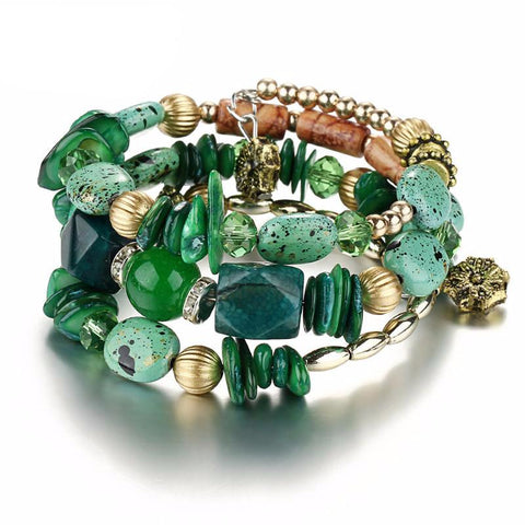 Picture of green version of bangles, beads and stone bracelet.