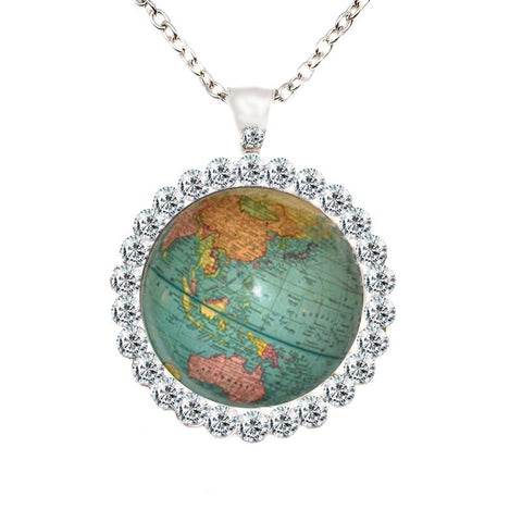Earth pendant with rhinestones against a white background.