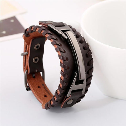 Picture of leather and metal men's bracelet standing upright.