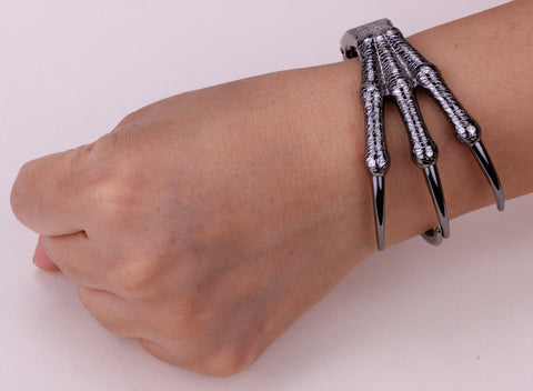 Picture of claw bracelet being worn.