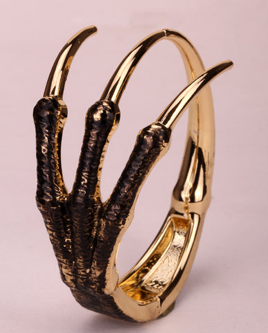 Picture of gold claw bracelet.