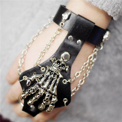Picture of skeleton hand glove bracelet on a hand.